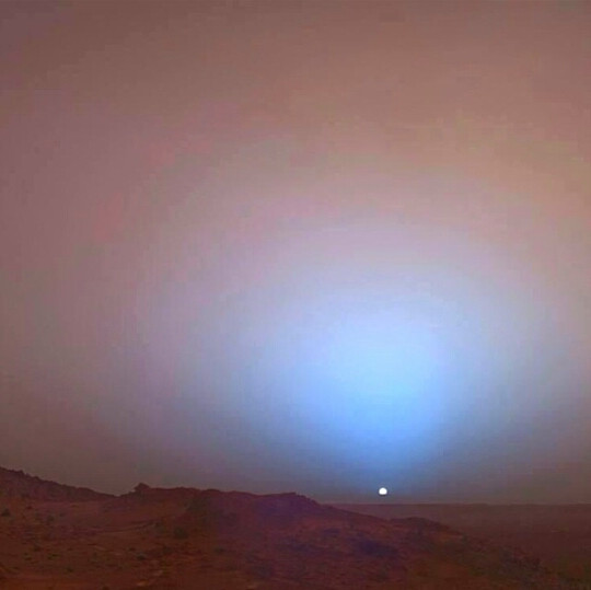 this spectacular sunset is out of this world! in fact, was taken on Mars, because the sunsets over there are blue and the sky is red :) totally unlike Earth ... it's amazing!
